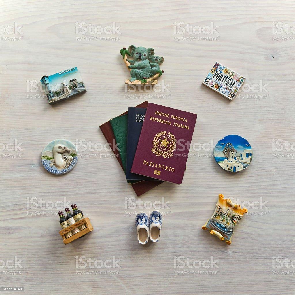 various passports and souvenir magnets stock photo