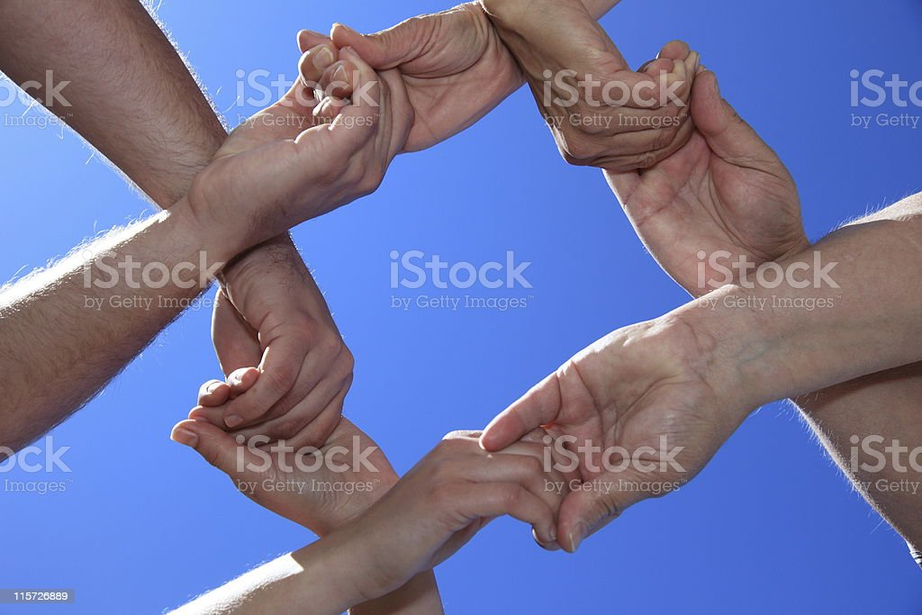Various people holding hands royalty-free stock photo