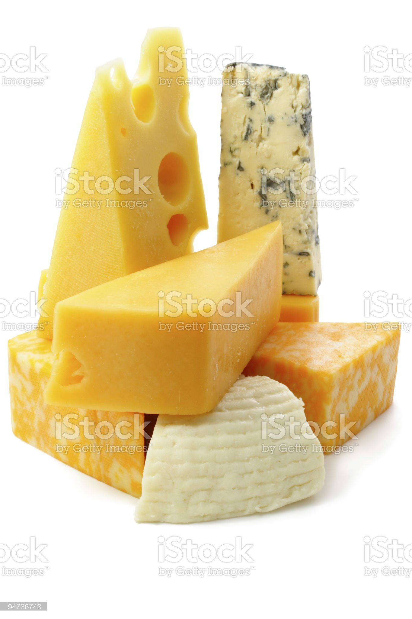 Various pieces of cheese representing different types royalty-free stock photo