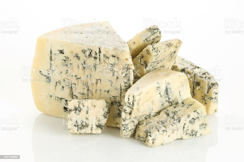 Various portions of blue cheesse on white backdrop stock photo