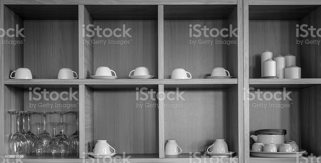 Various pottery in kitchen cupboard stock photo