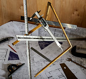 Various Rulers with Plans in Background