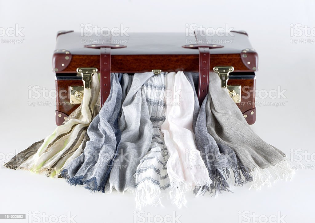 various scarfs hanging out of vintage leather suitcase royalty-free stock photo