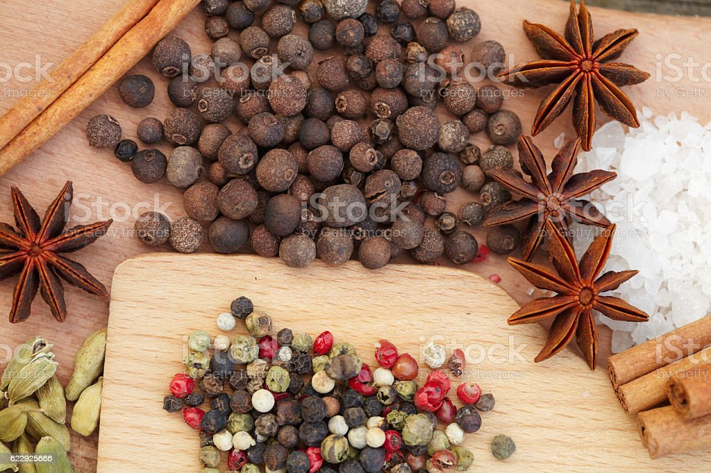 Various seasonings on wooden background stock photo