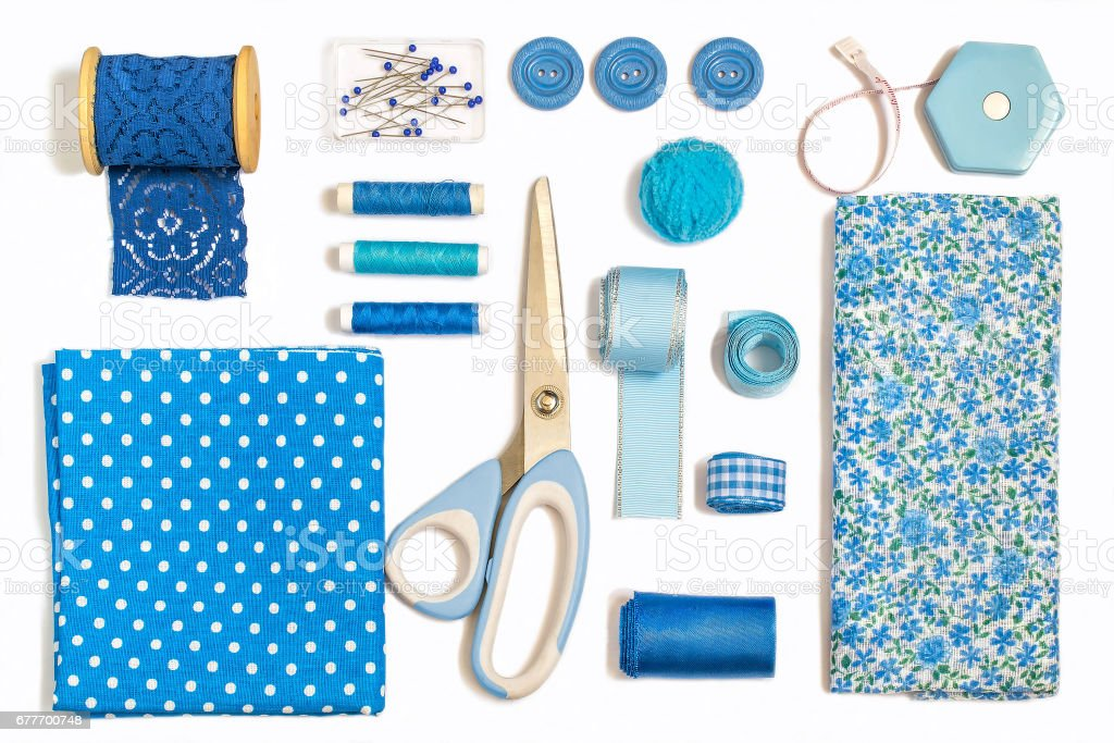 Various sewing accessories and tools blue shades stock photo