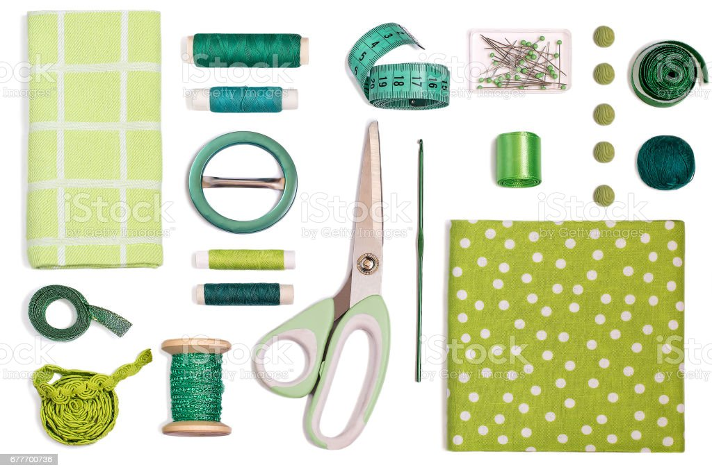 Various sewing accessories and tools green shades stock photo