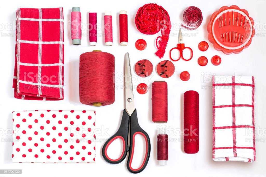 Various sewing accessories and tools red shades stock photo