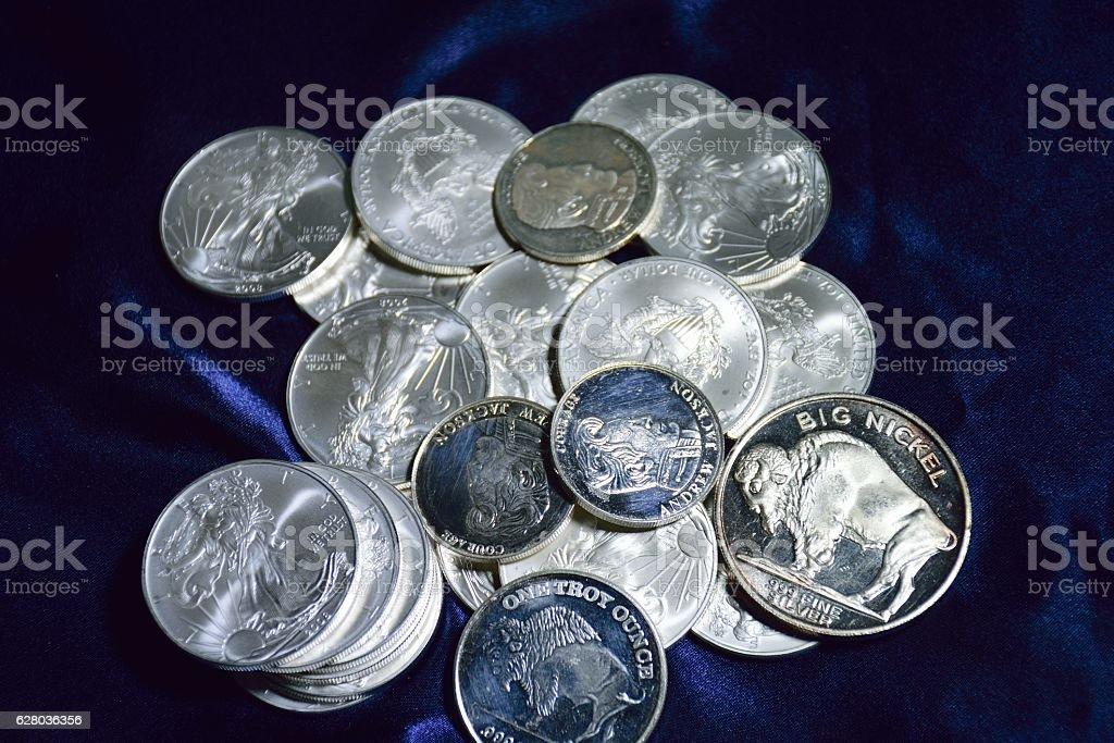 various silver coins stock photo
