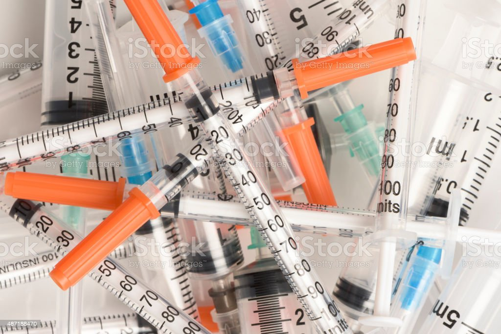 Various sized sterilized plastic medical syringes in a large pil stock photo