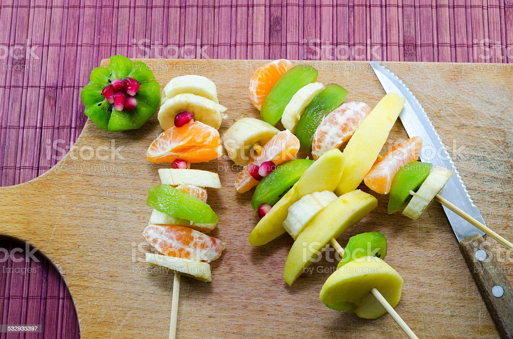 Various skewered fruit on a cutting board royalty-free stock photo