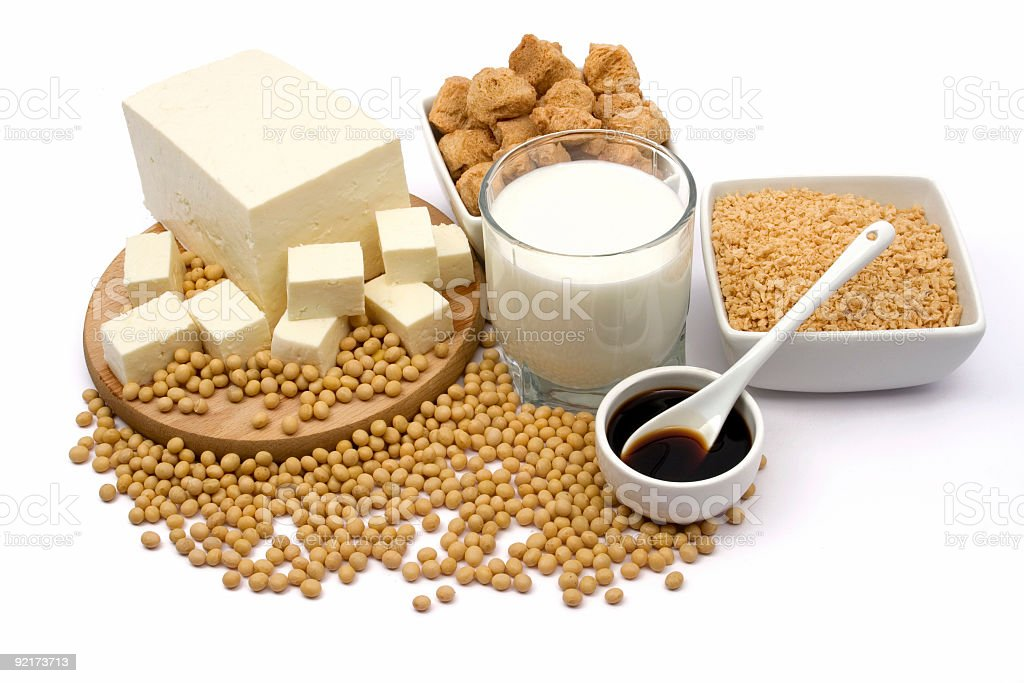 Various soy products surrounded by soybeans stock photo