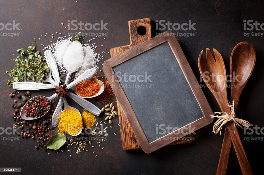 Various spices and chalkboard stock photo