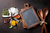 Various spices and chalkboard