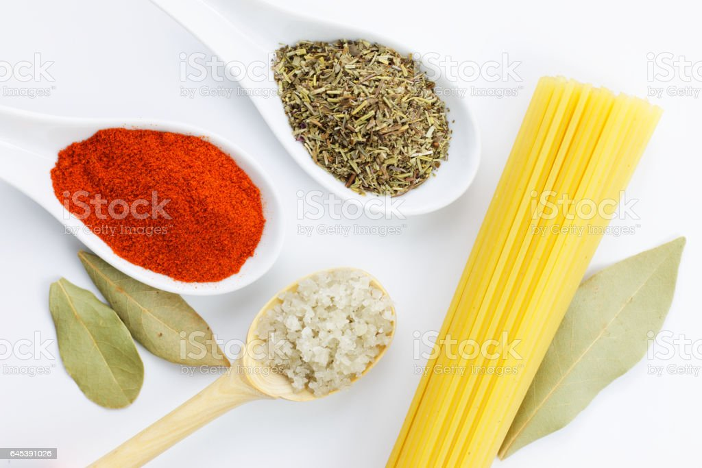 Various spices and spaghetti stock photo