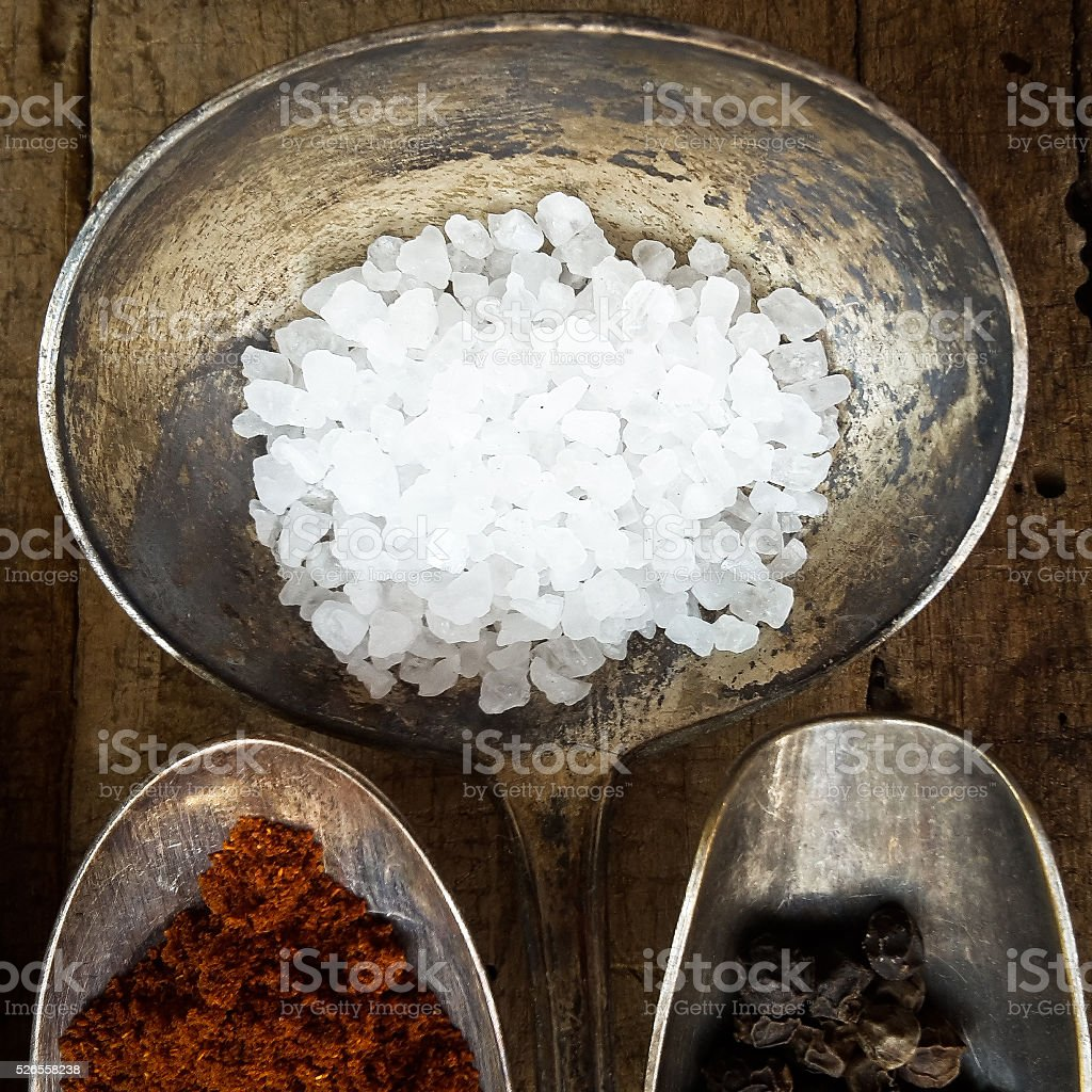 Various spices at wooden table stock photo