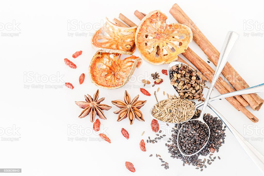 Various spices, herb  and ingredients on white background stock photo