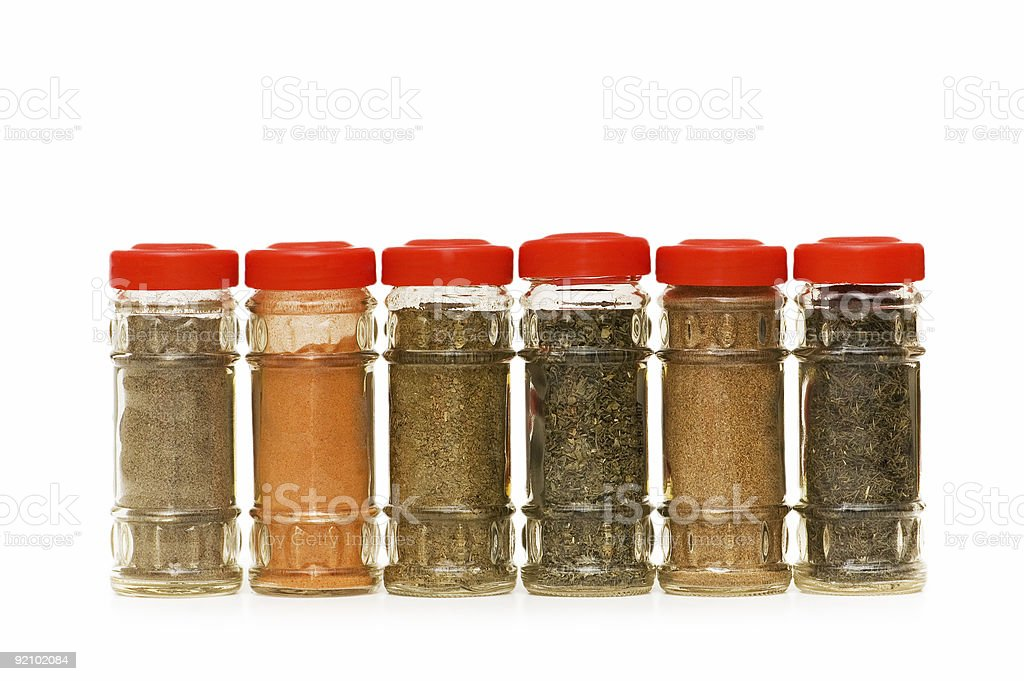 Various spices in bottles isolated on white royalty-free stock photo