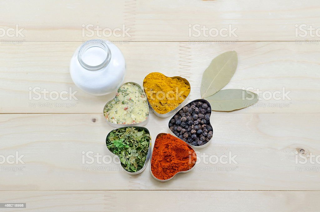 Various spices in heart chaped containers on a table royalty-free stock photo