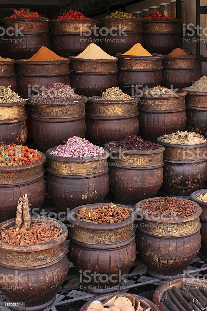 Various spices in large bows lined up in rows royalty-free stock photo