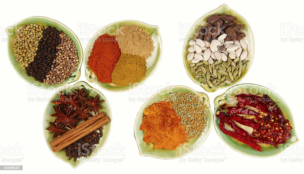 various Spices in six leaf shape plates isolated royalty-free stock photo