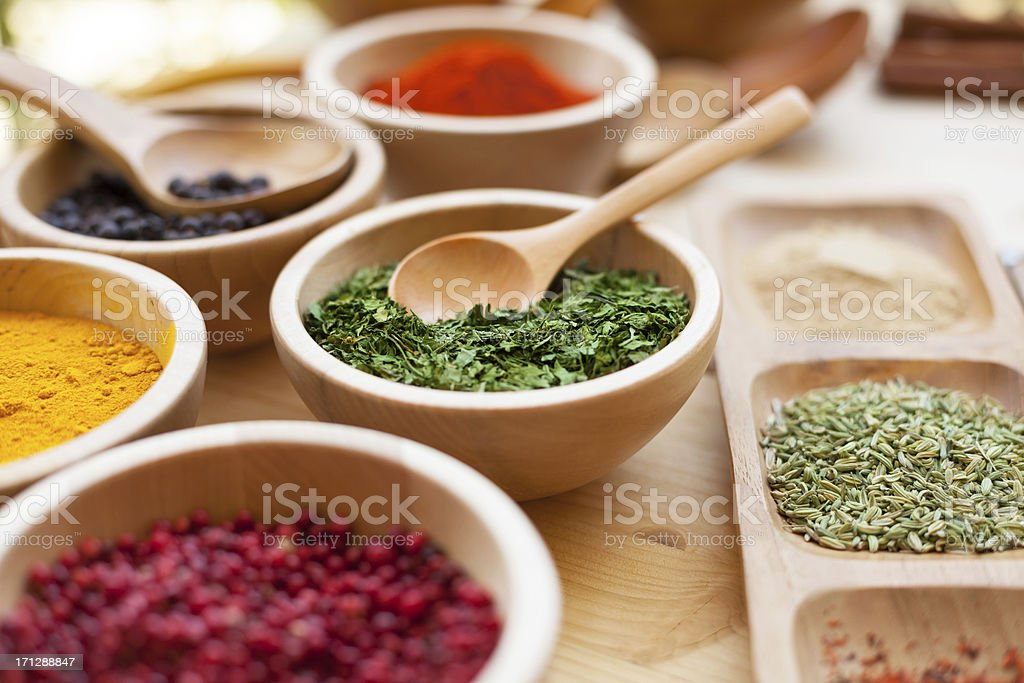 Various spices in wooden bowl royalty-free stock photo