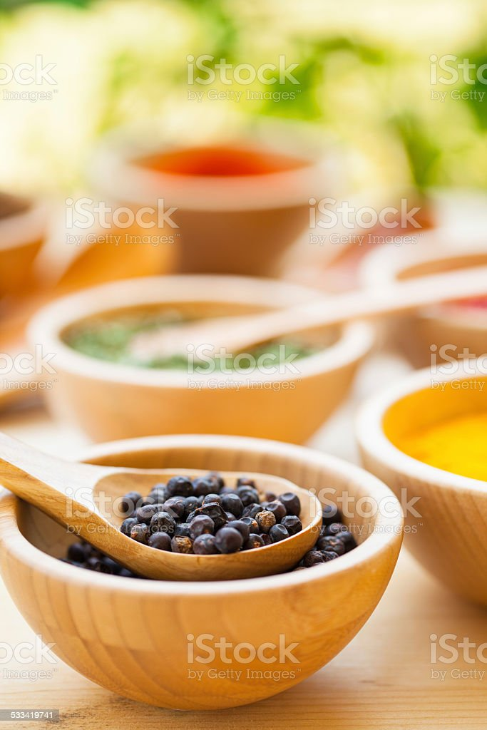 Various spices in wooden bowl stock photo