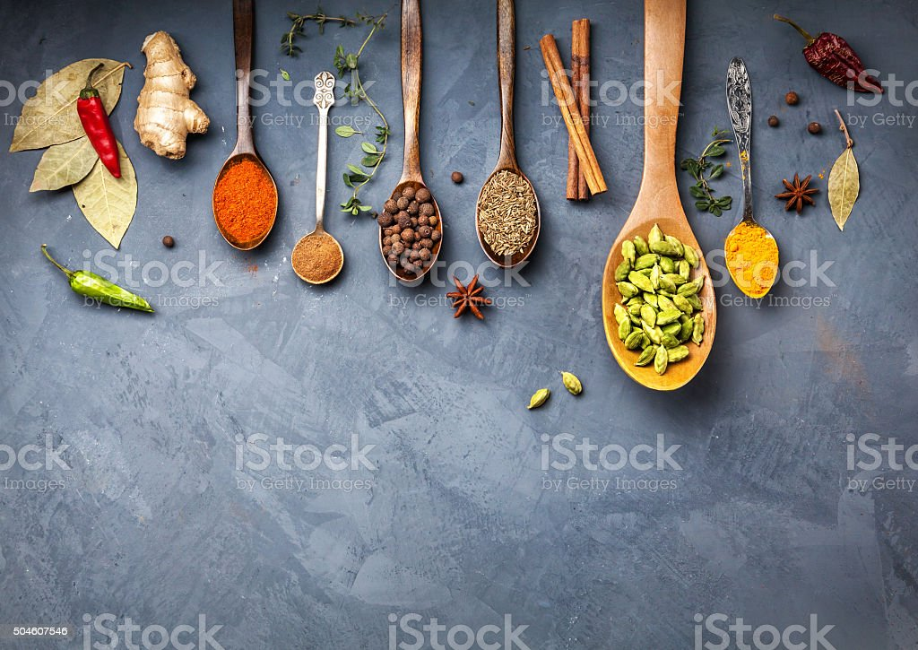 Various Spices near blackboard at blue stone background stock photo