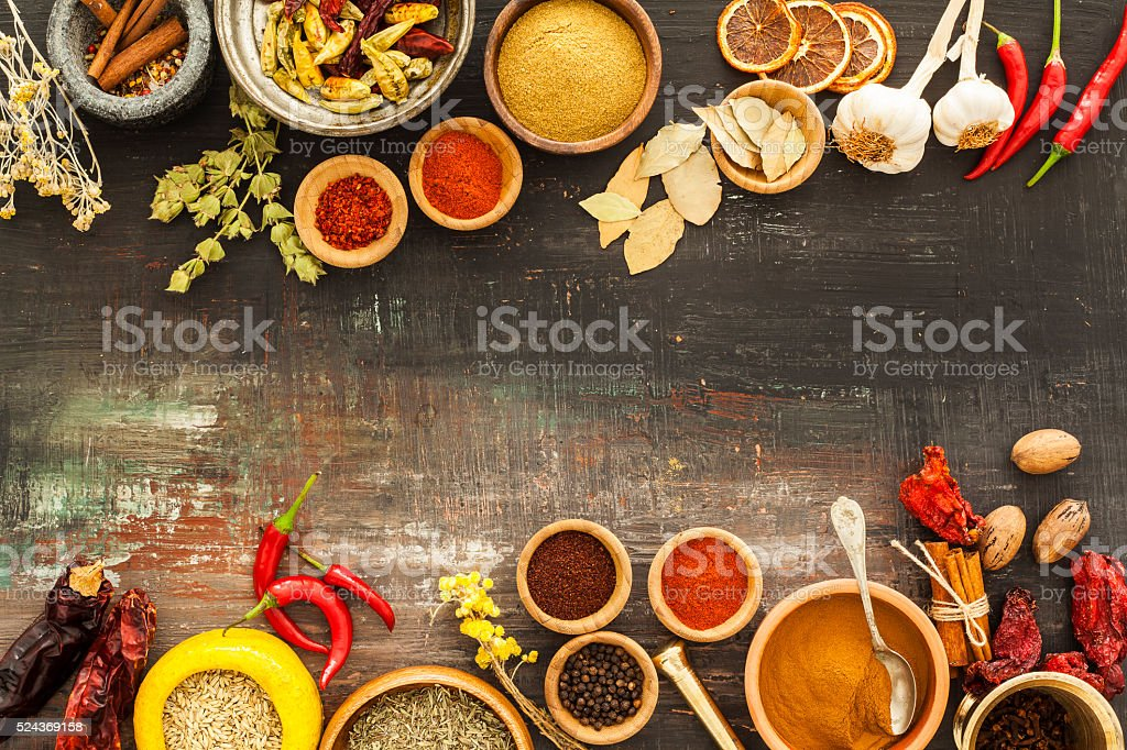 Various spices on vintage board stock photo