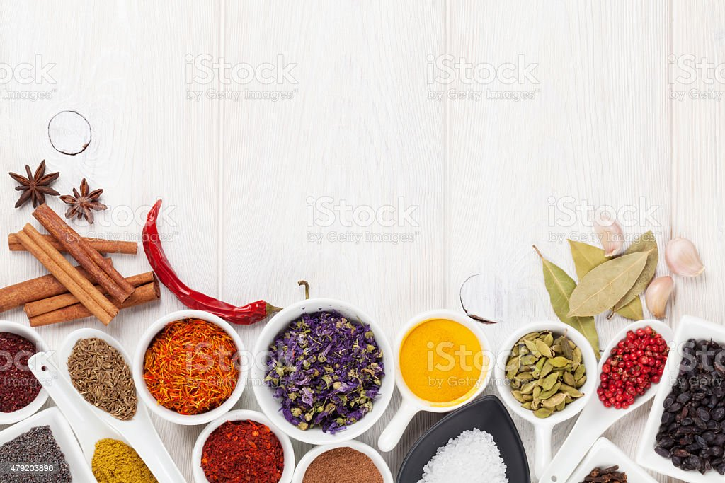 Various spices on white wooden background stock photo