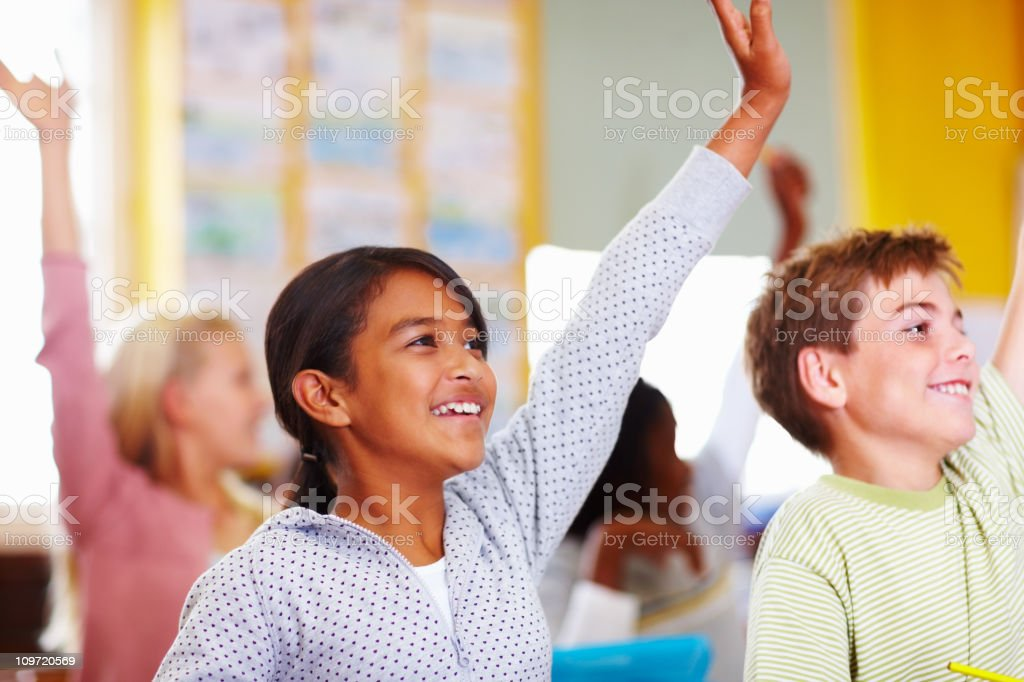 Various students in class raising hands royalty-free stock photo
