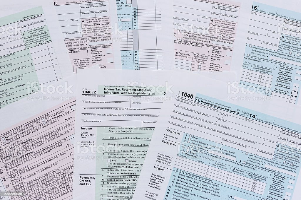 various tax forms as a background stock photo