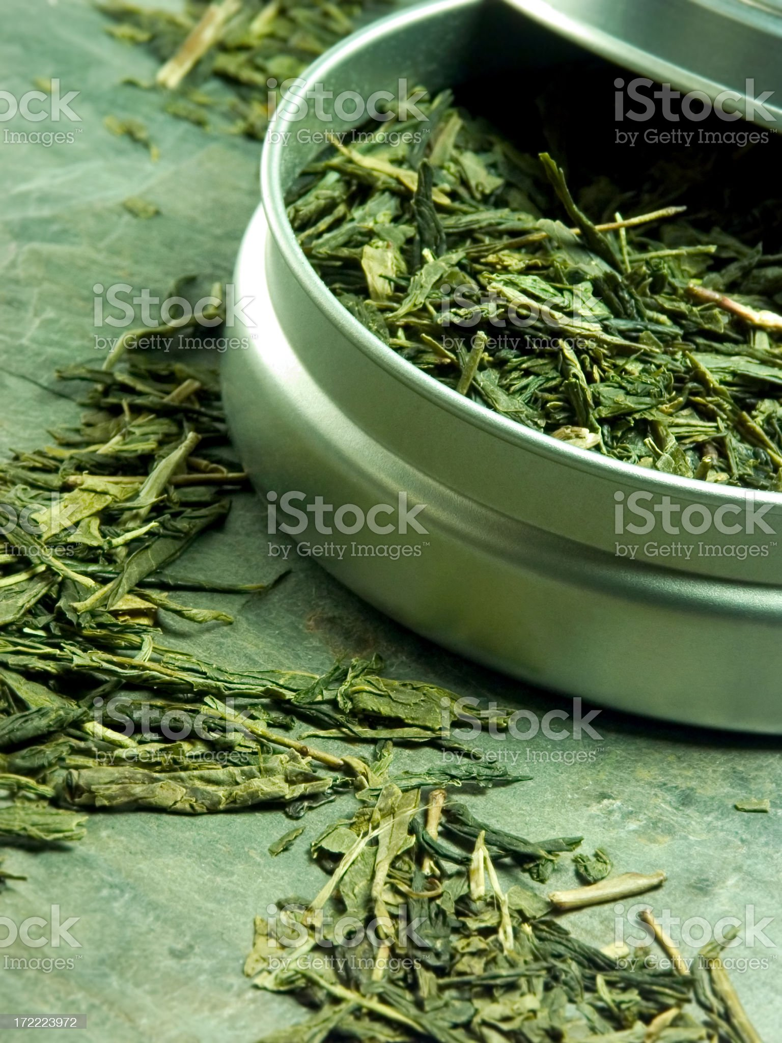 Various tea leaves being ground up royalty-free stock photo