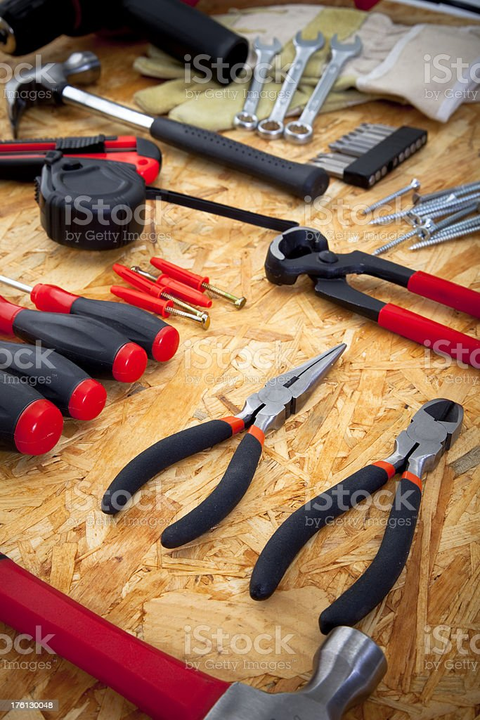 Various tools on chipboard stock photo