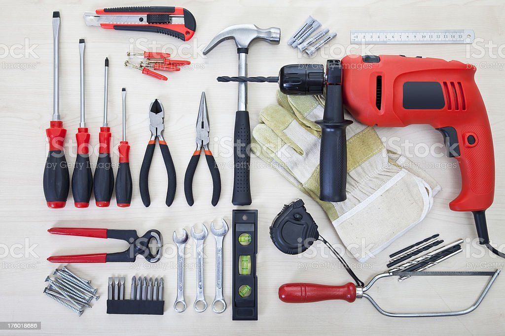 Various tools on the white wood surface stock photo