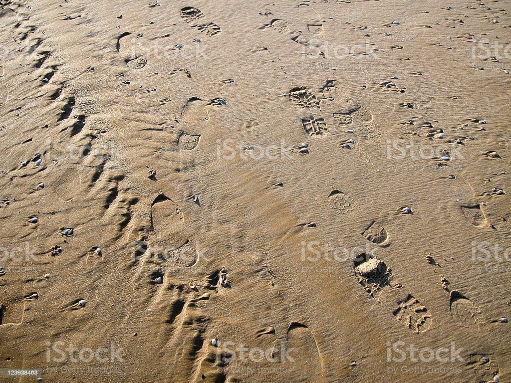 Various tracks in the sand, including footprints and tire, Turkey royalty-free stock photo
