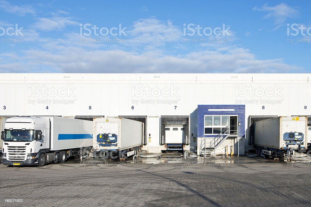 Various trips being loaded in a distribution center stock photo