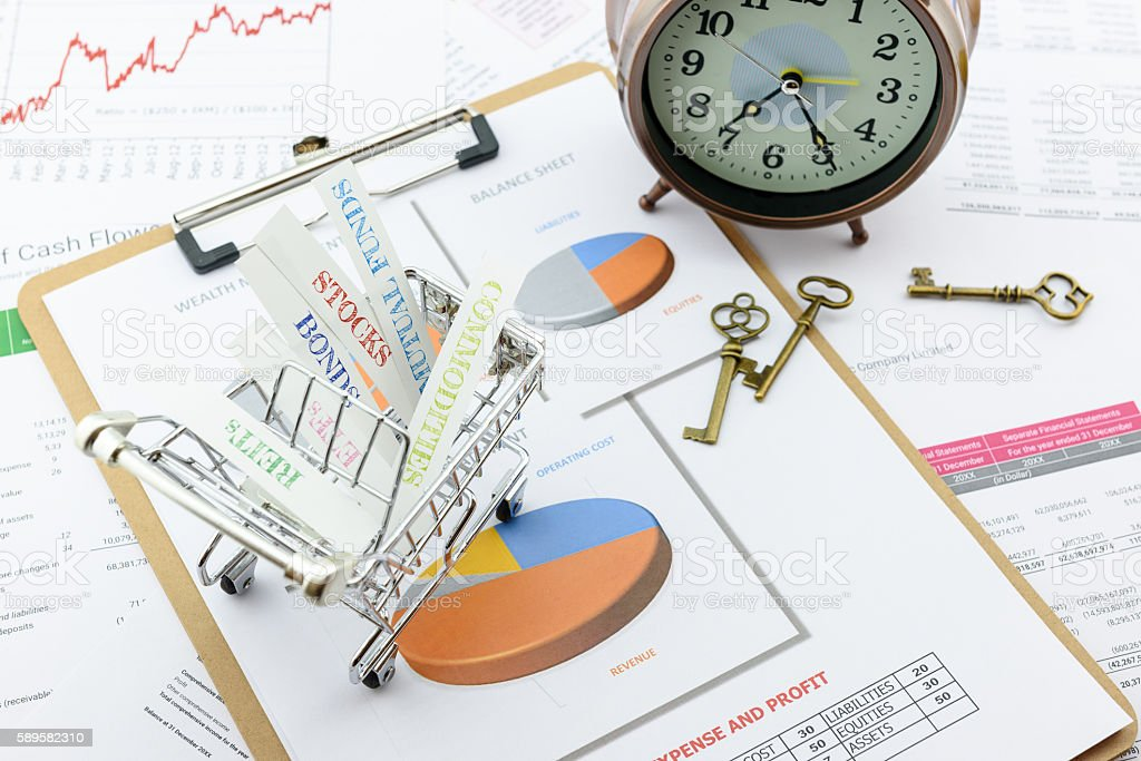 Various type of financial and investment products in a cart. stock photo