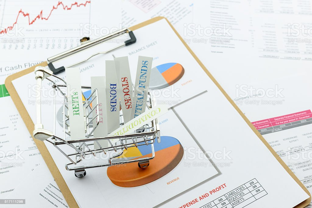 Various type of financial and investment products in a trolley. stock photo