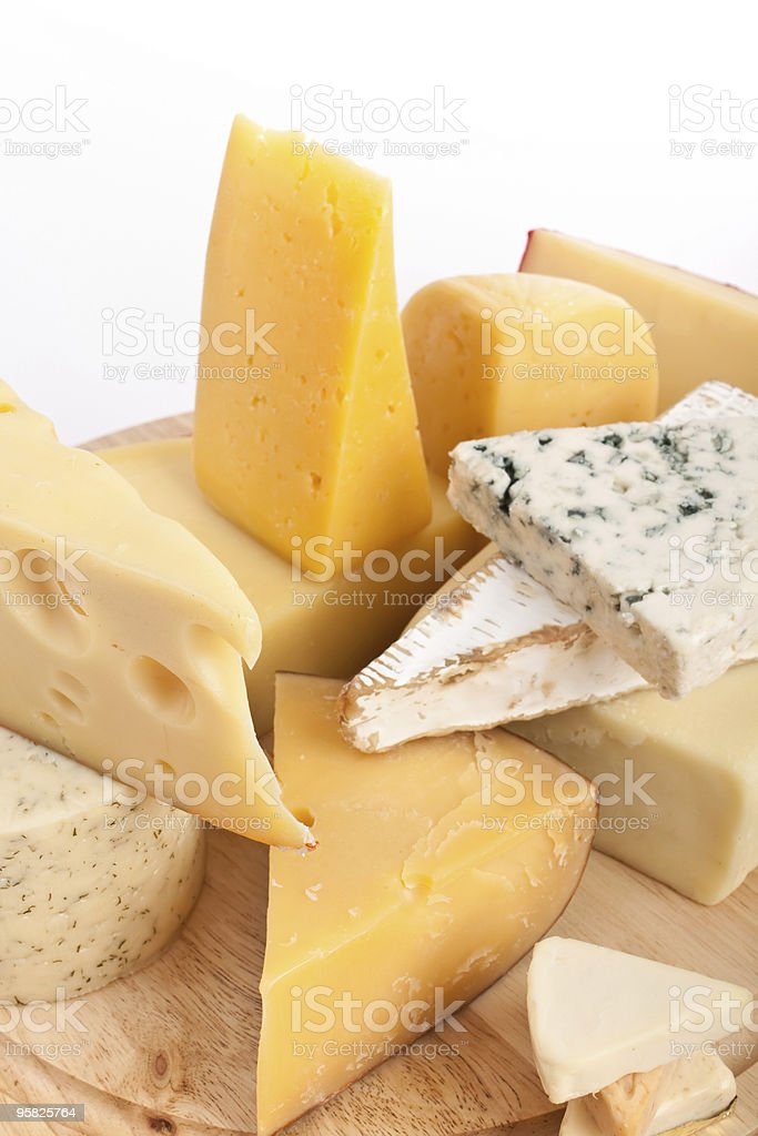 Various types of cheese on wooden board royalty-free stock photo