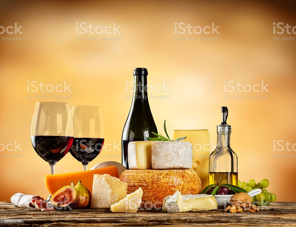 Various types of cheese with red wine stock photo