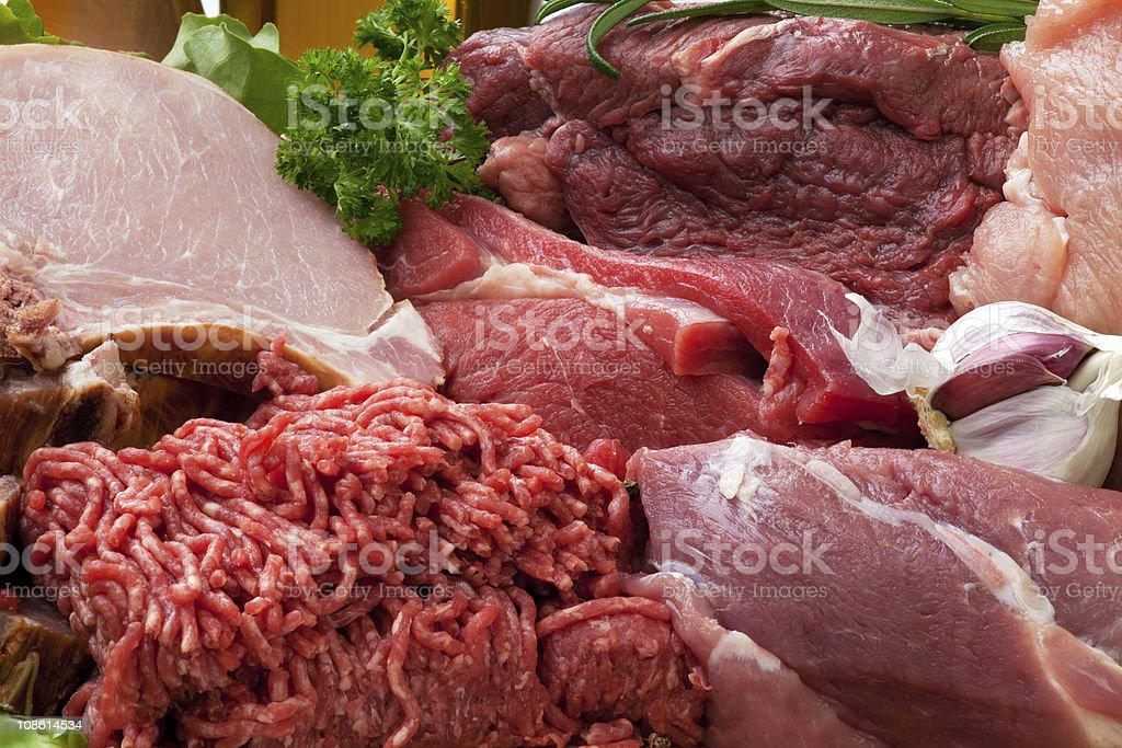 Various types of fresh raw meat piles royalty-free stock photo