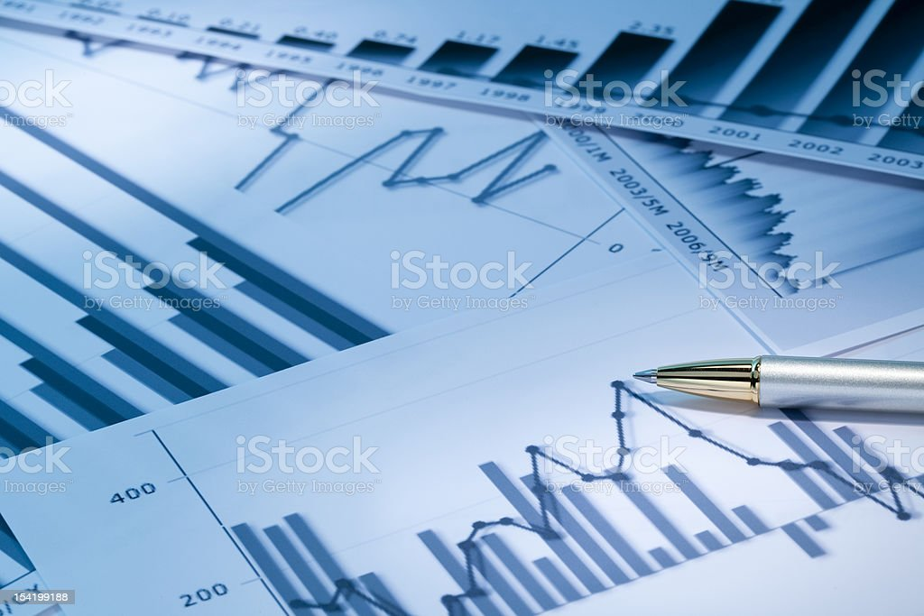 Various types of graphs and charts on white paper royalty-free stock photo