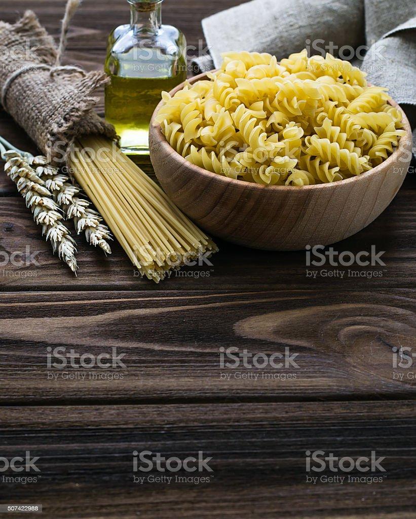 Various types of uncooked Italian pasta stock photo