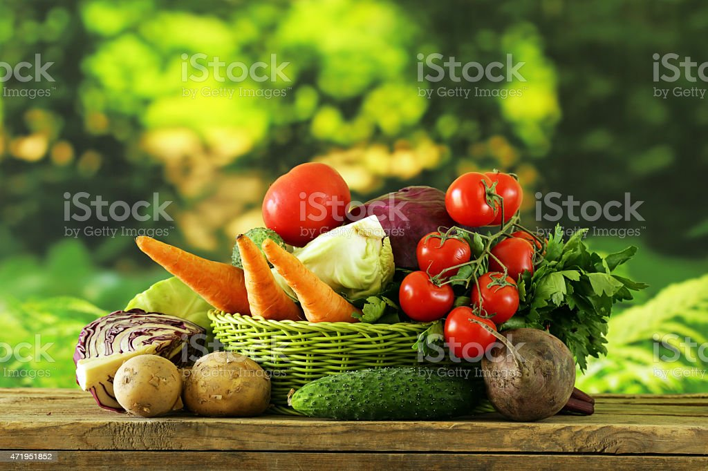 Various types of vegetables in a basket stock photo