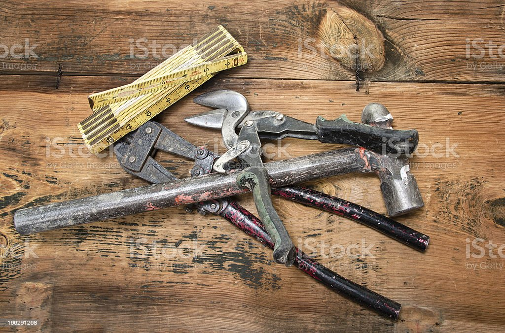 Various Used Construction Work tools on wood  bench stock photo