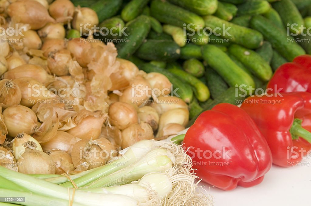 Various vegetables at a market: peppers, onions, gherkins stock photo
