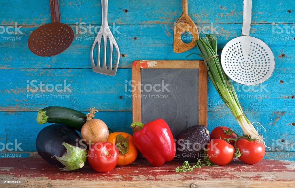 various vegetables, kitchen utensils, blackboard, free copy spac stock photo