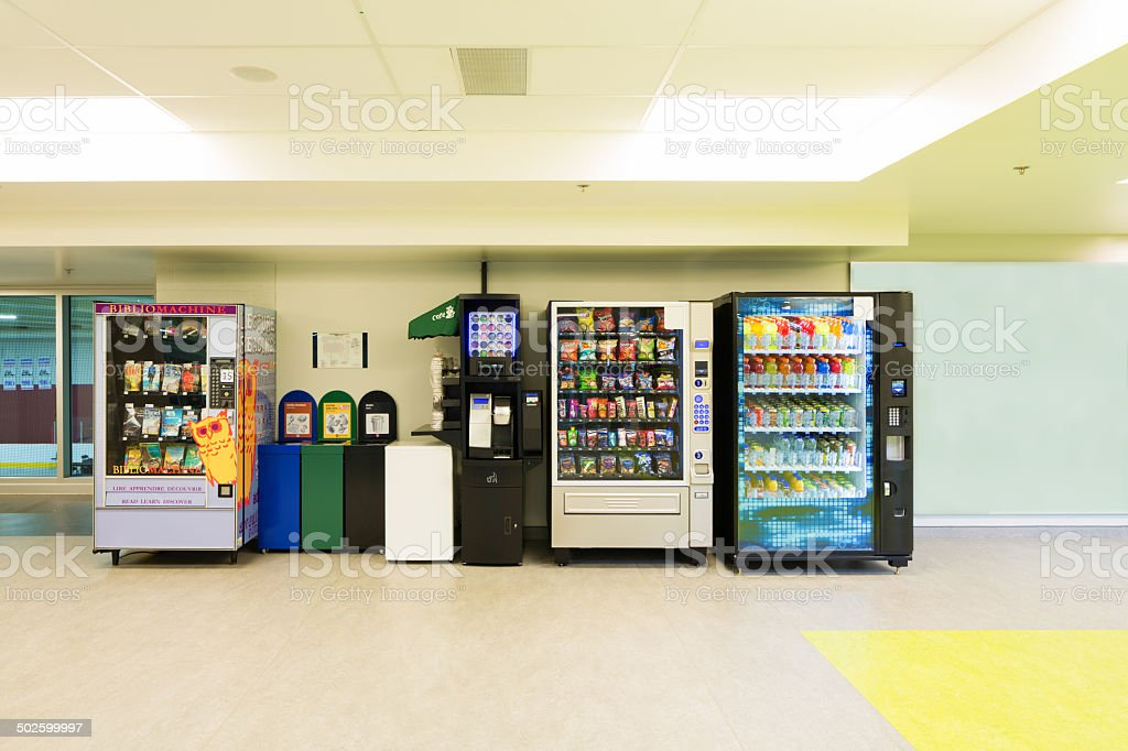Various vending machines and trash cans stock photo