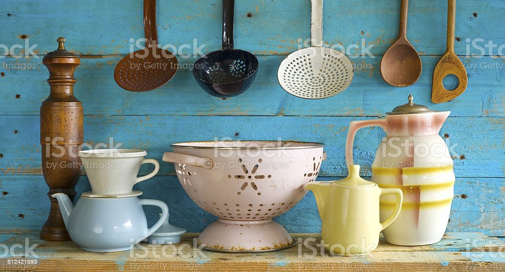 various vintage kitchen utensils,against blue wooden wall stock photo