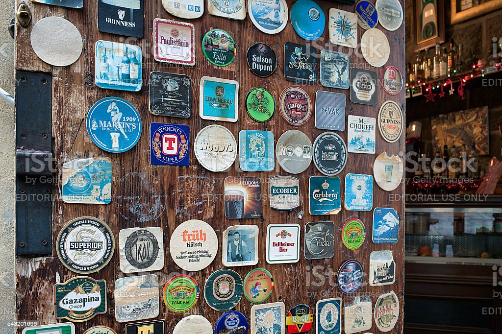 Various Vintage Table Coasters Inside Pub Arezzo stock photo